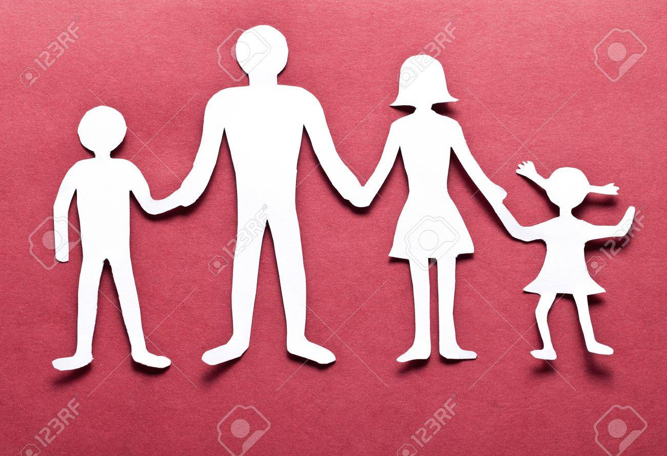 Cardboard Figures Of The Family On A Red Background The Symbol