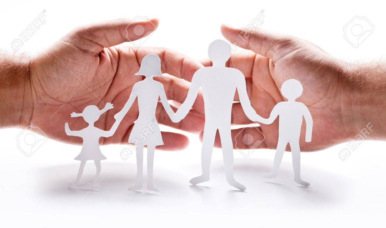 Cardboard Figures Of The Family On A White Background The Symbol