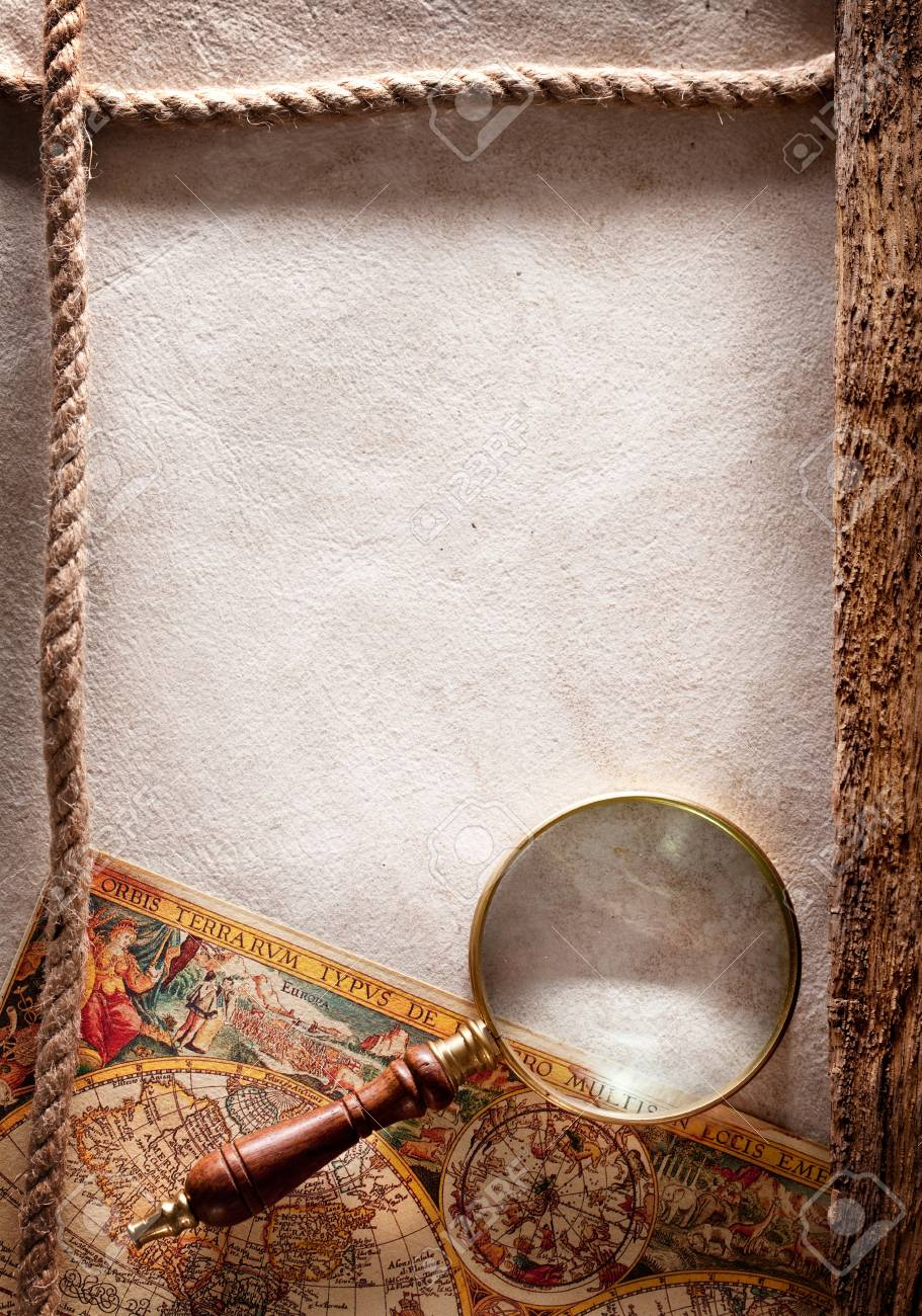 Magnifying glass on old parchment Stock Photo - 17276931