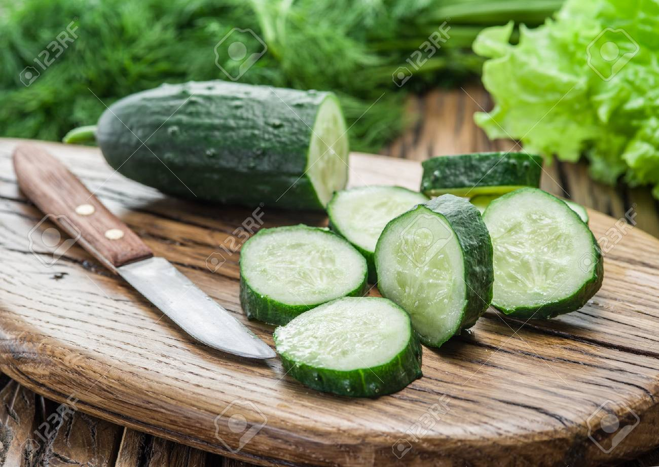 Cucumbers on the wooden table. Standard-Bild - 54520680