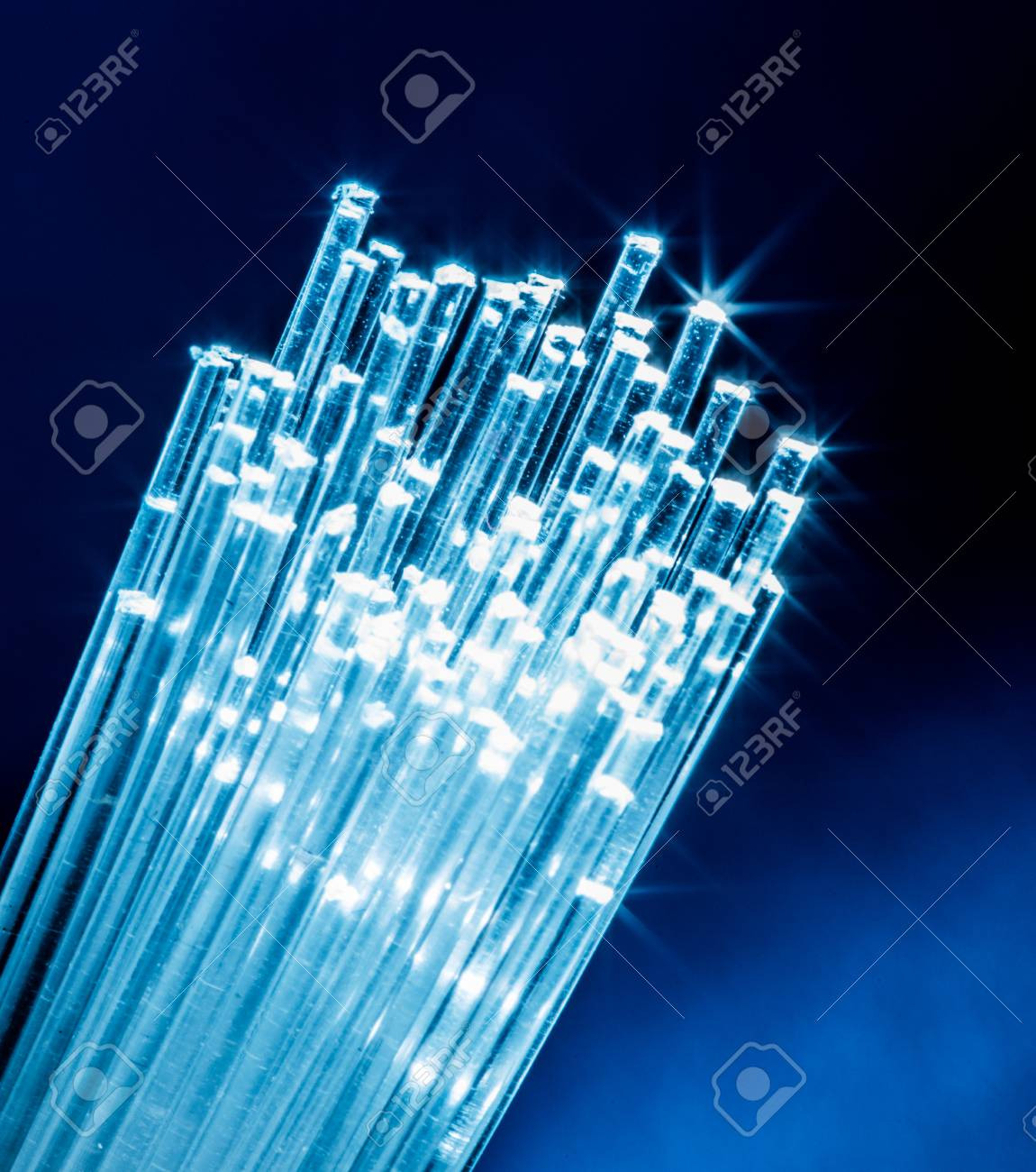 Bundle of optical fibers with lights in the ends. - 121830037