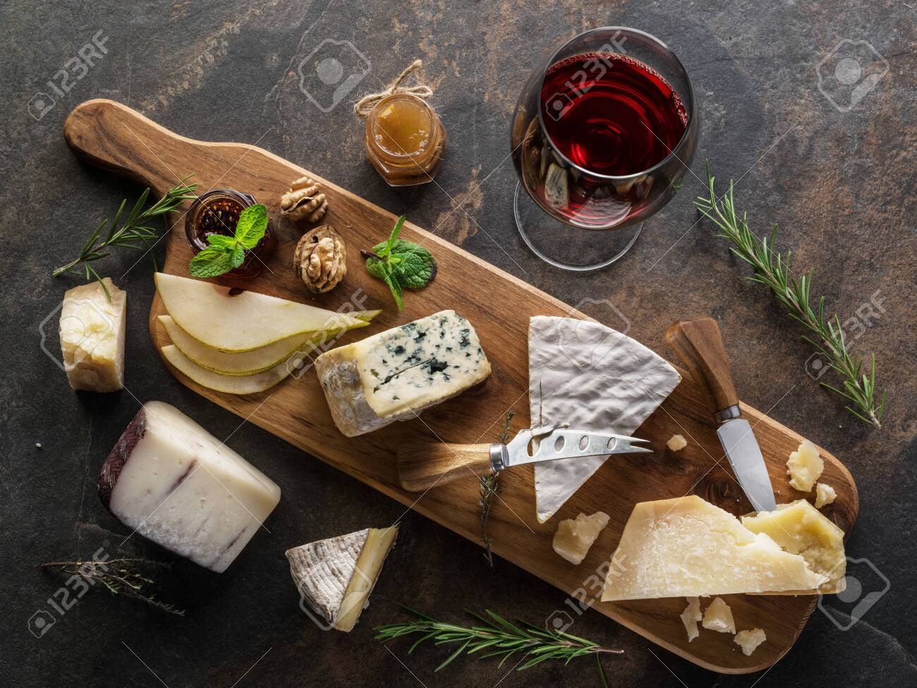 Cheese Platter With Organic Cheeses Fruits Nuts And Wine On Stock Photo Picture And Royalty Free Image Image 124868311