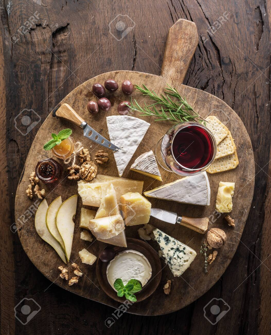 Cheese Platter With Organic Cheeses Fruits Nuts And Wine On Stock Photo Picture And Royalty Free Image Image 128196456