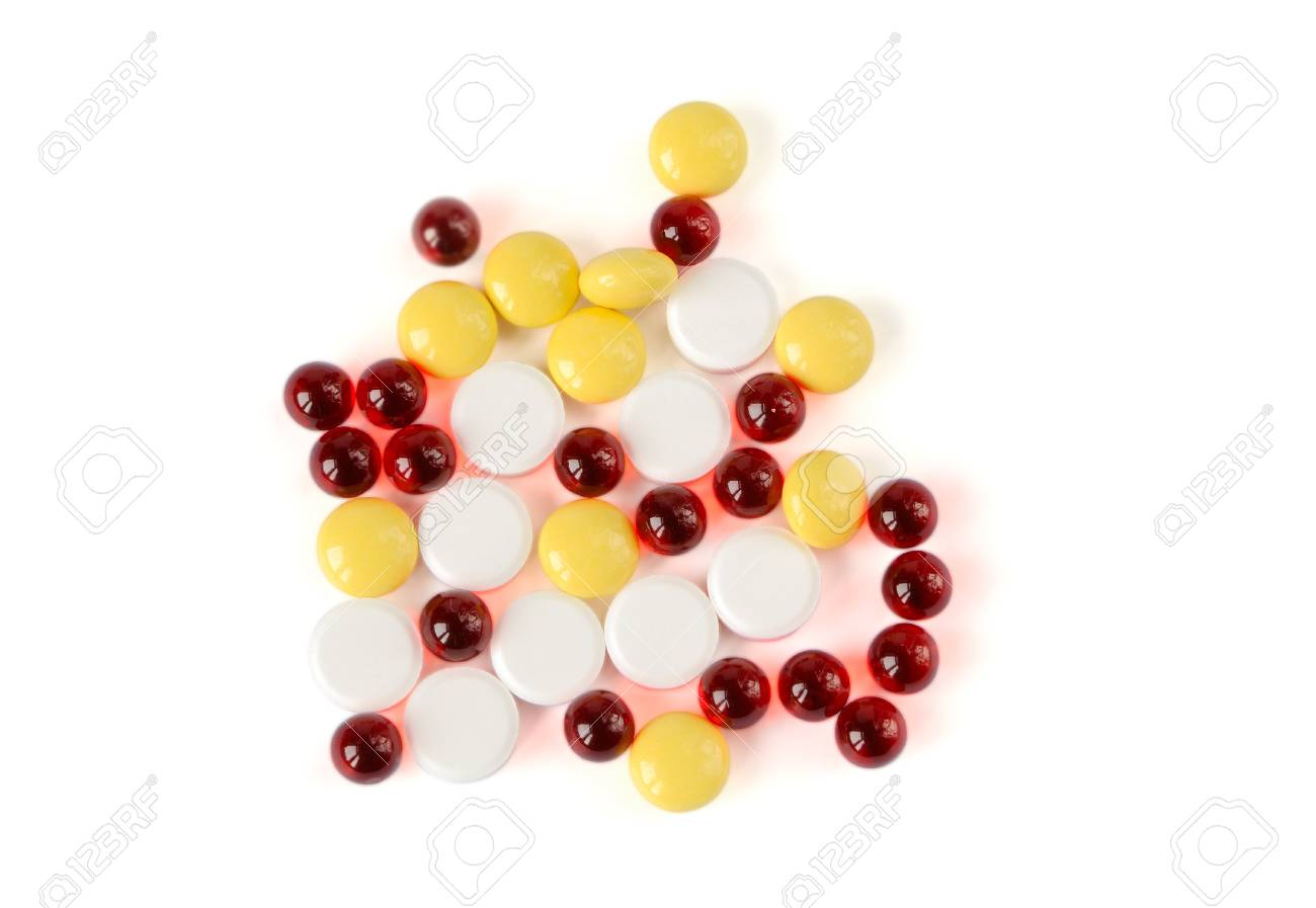 Colored pills on a white background Stock Photo - 16358682