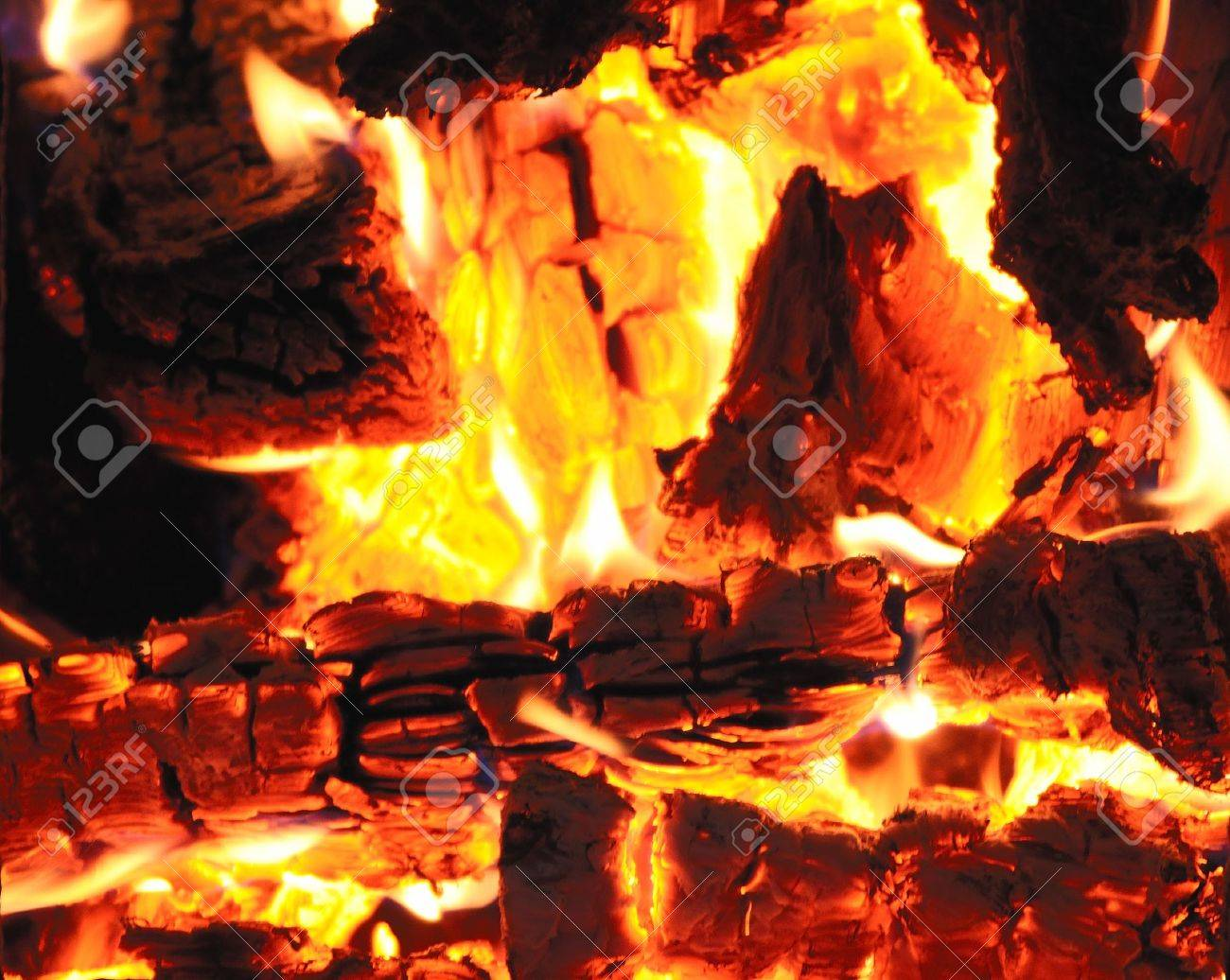 firewood burning in a fireplace closeup stock photo picture and