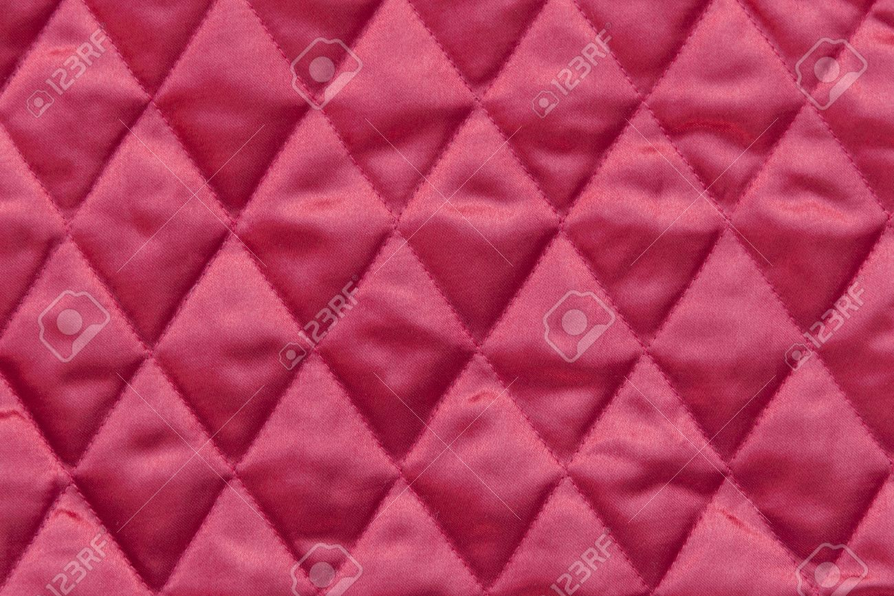 close up of quilted christmas tree skirt fabric in traditional red color stock photo 16460224 - Pink Christmas Tree Skirt