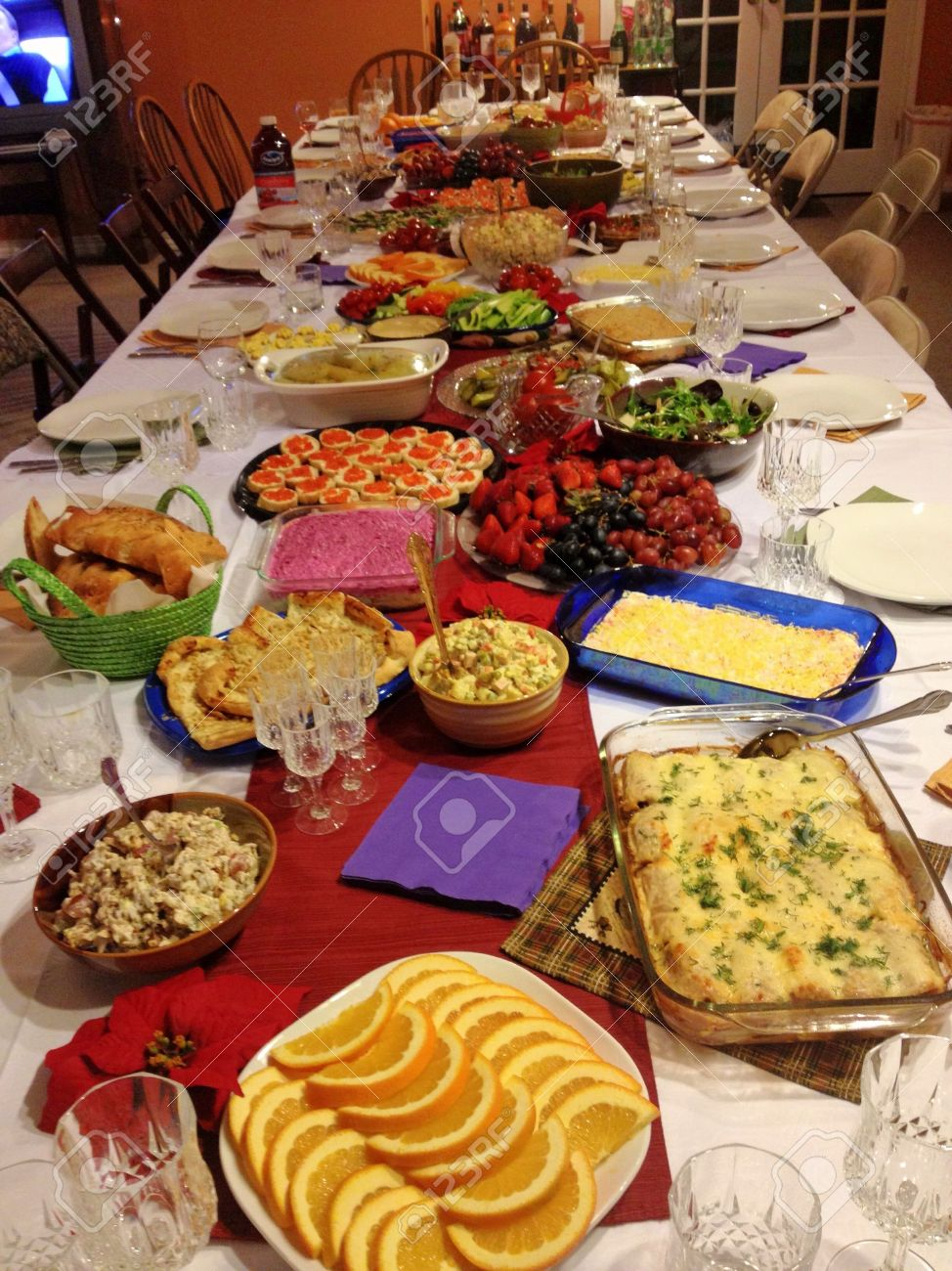 New Year Celebration With Traditional Russian Feast At Big Table. Stock  Photo, Picture And Royalty Free Image. Image 24885523.