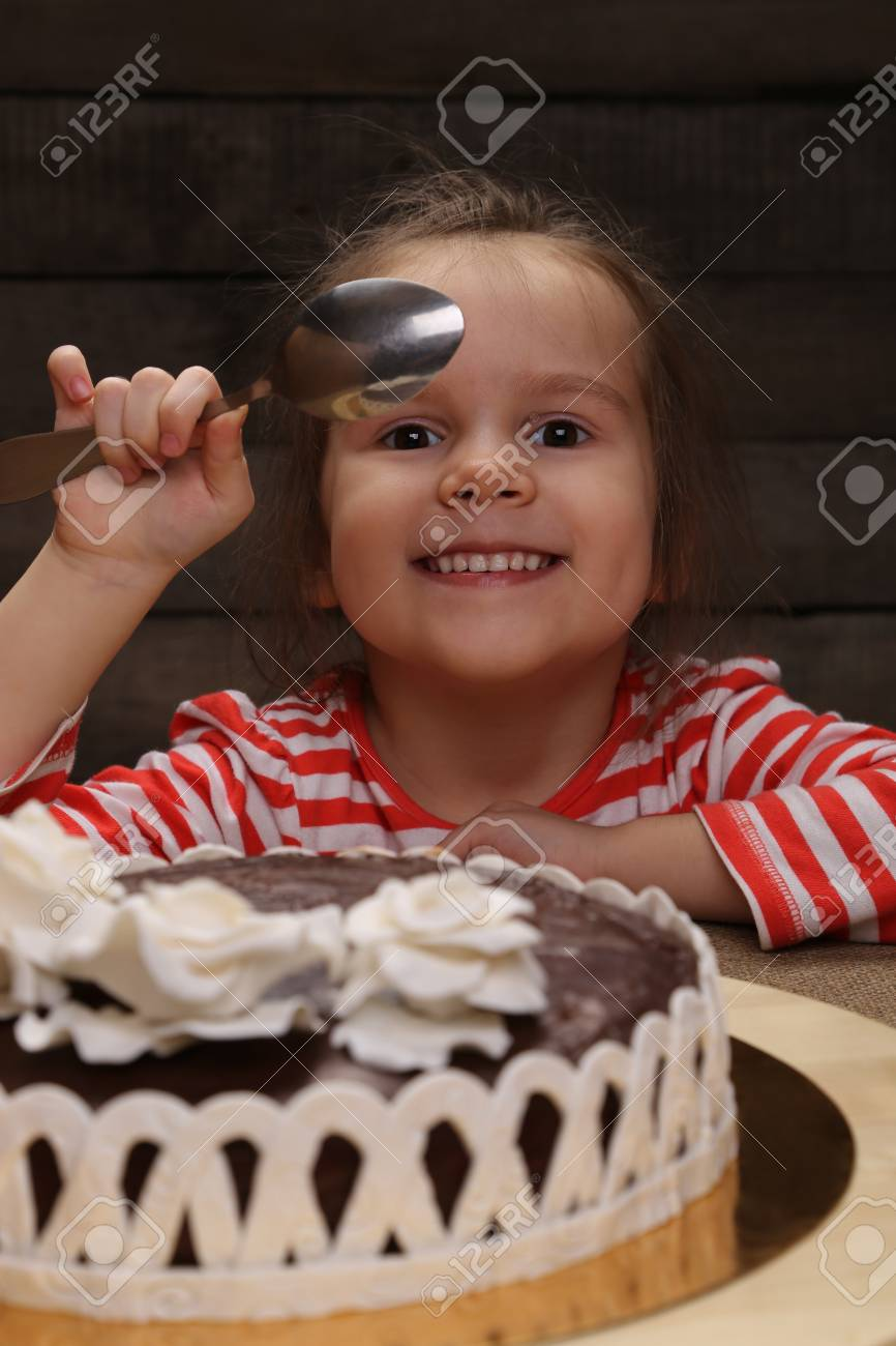 Cute Excited Smiling Little Girl With Spoon In Hand Going To Stock
