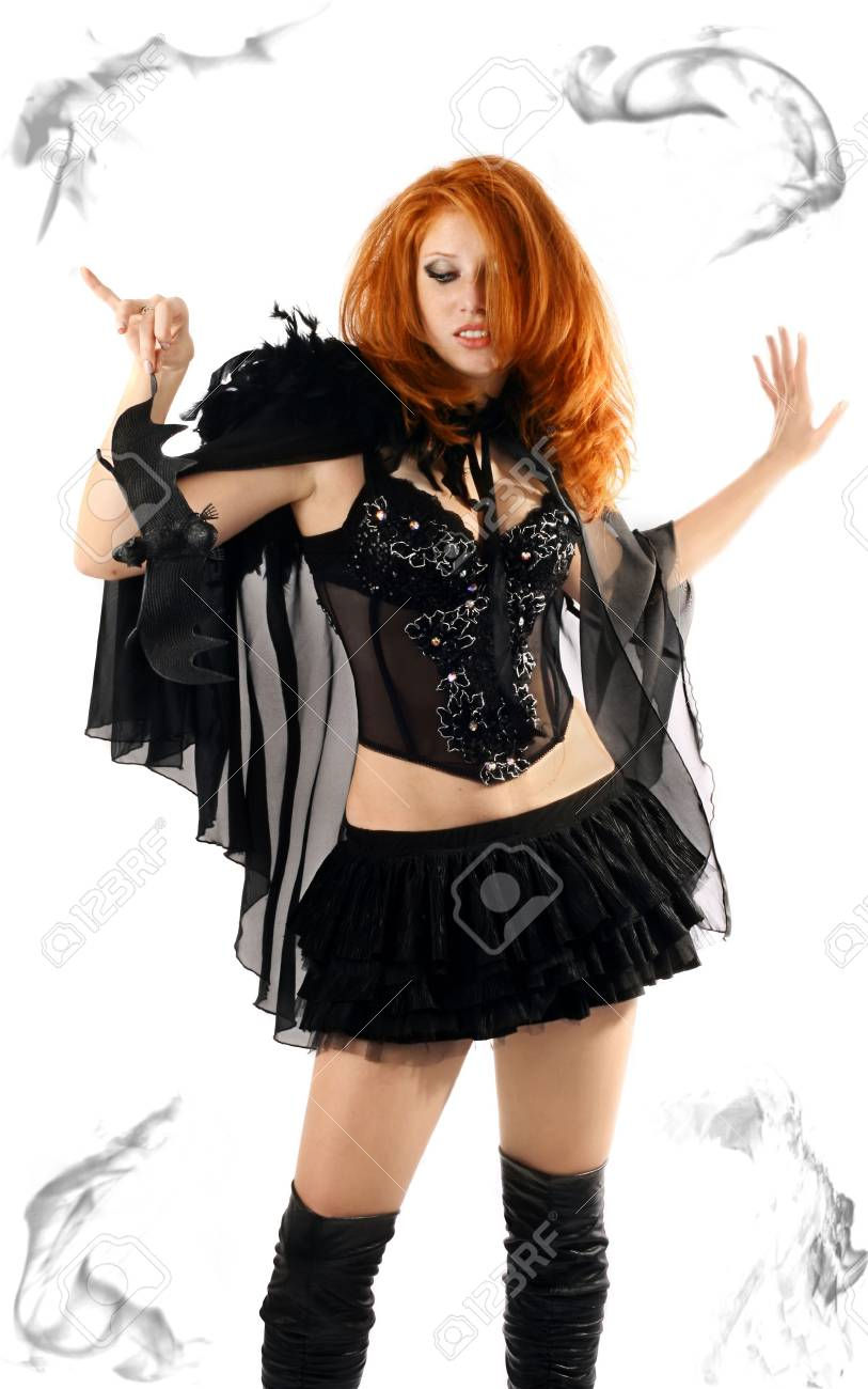 Portrait of a young beautiful witch in the black dress Stock Photo - 3689873