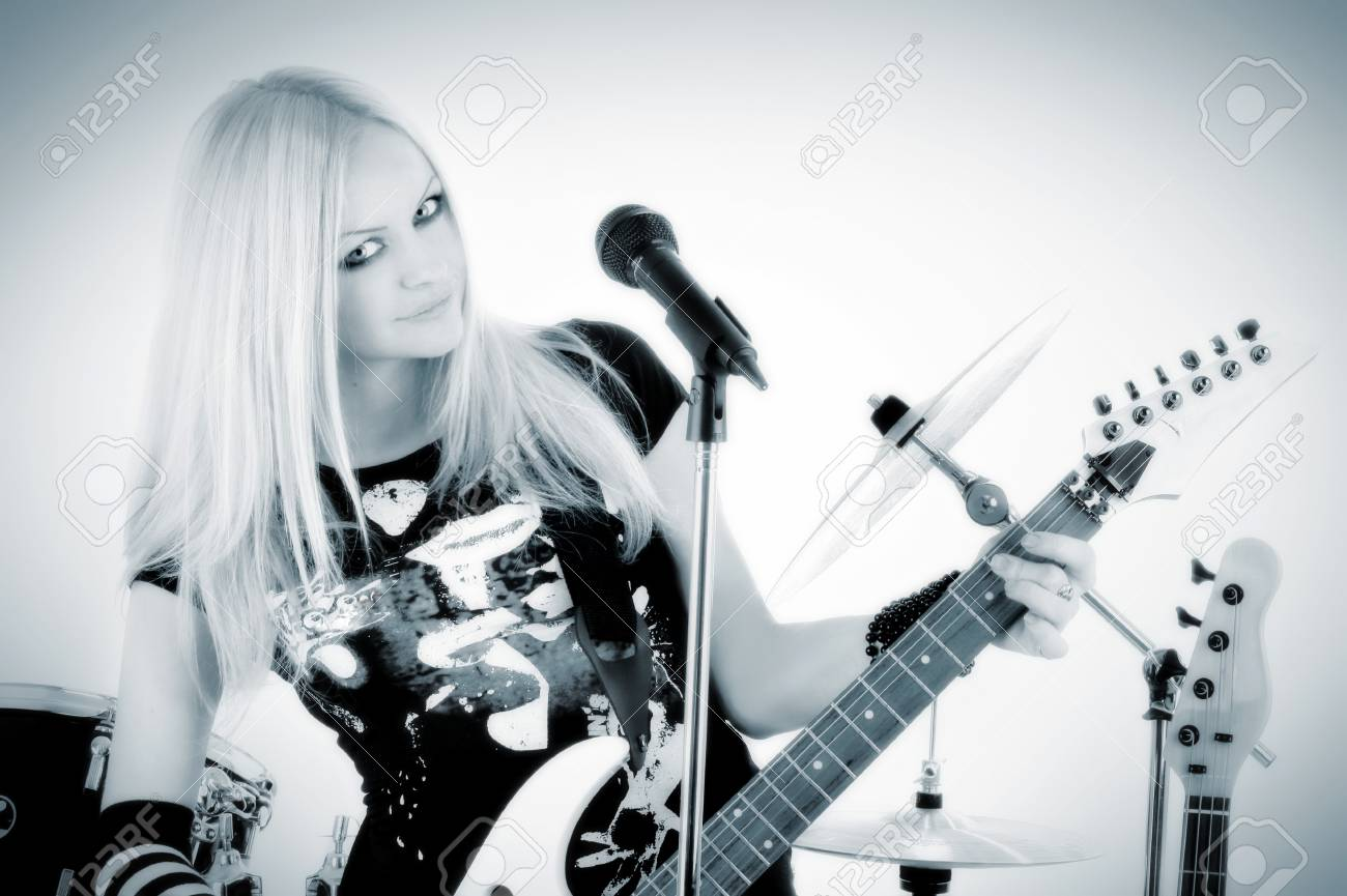 photo series in style rock-n-roll with the beautiful blonde Stock Photo - 4074781