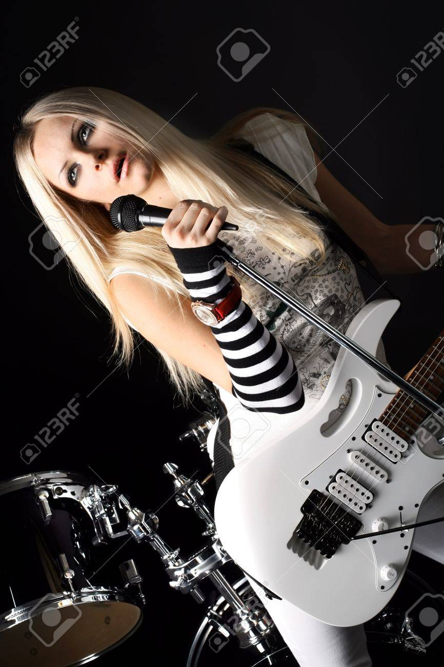 photo series in style rock-n-roll with the beautiful blonde Stock Photo - 4074840