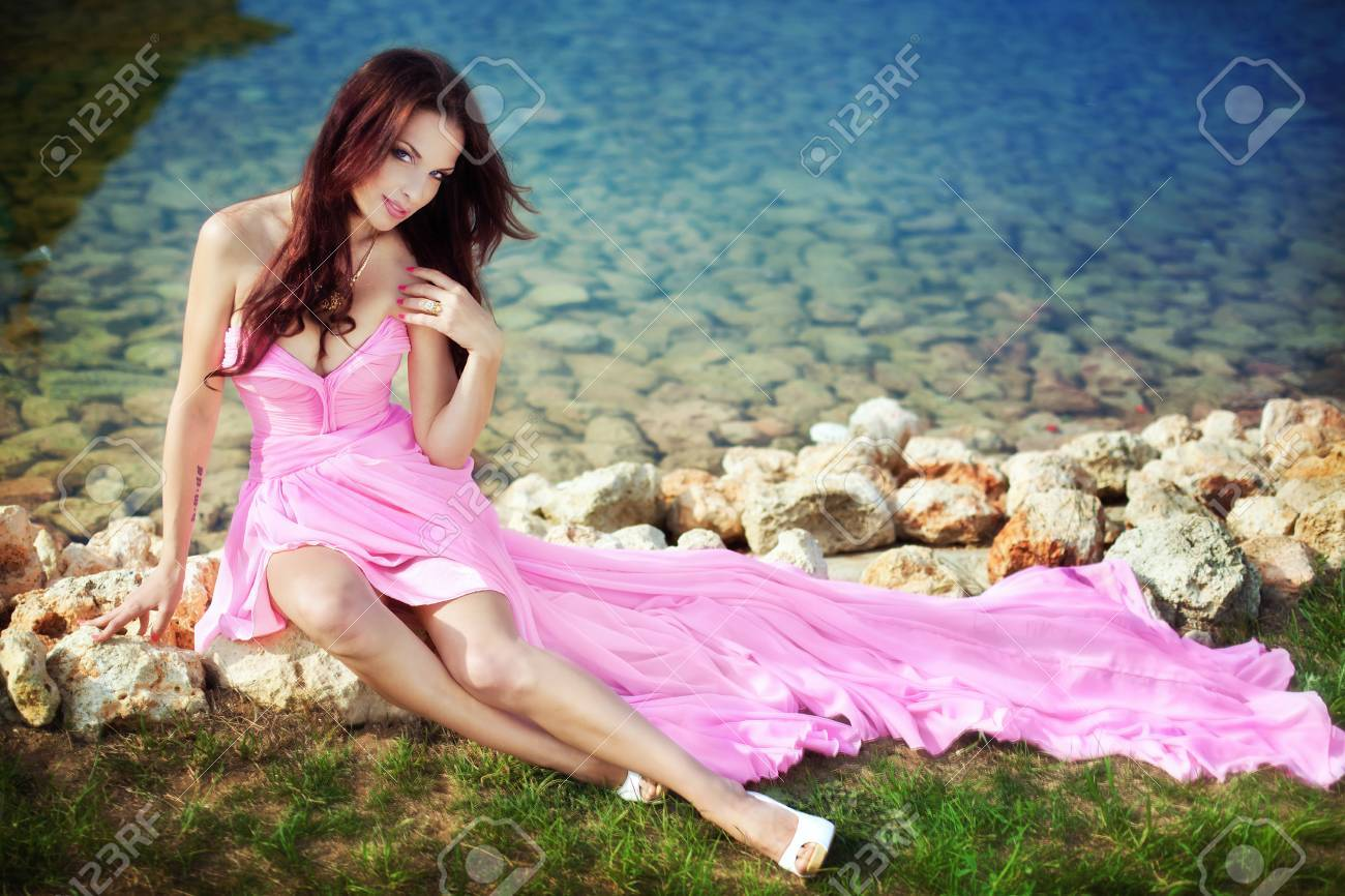 The beautiful harmonous girl in a long pink dress Stock Photo - 13878099