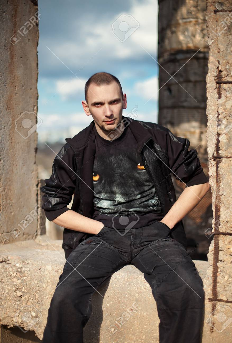 portrait of serious looking man in leather jacket outdoors Stock Photo - 14636690