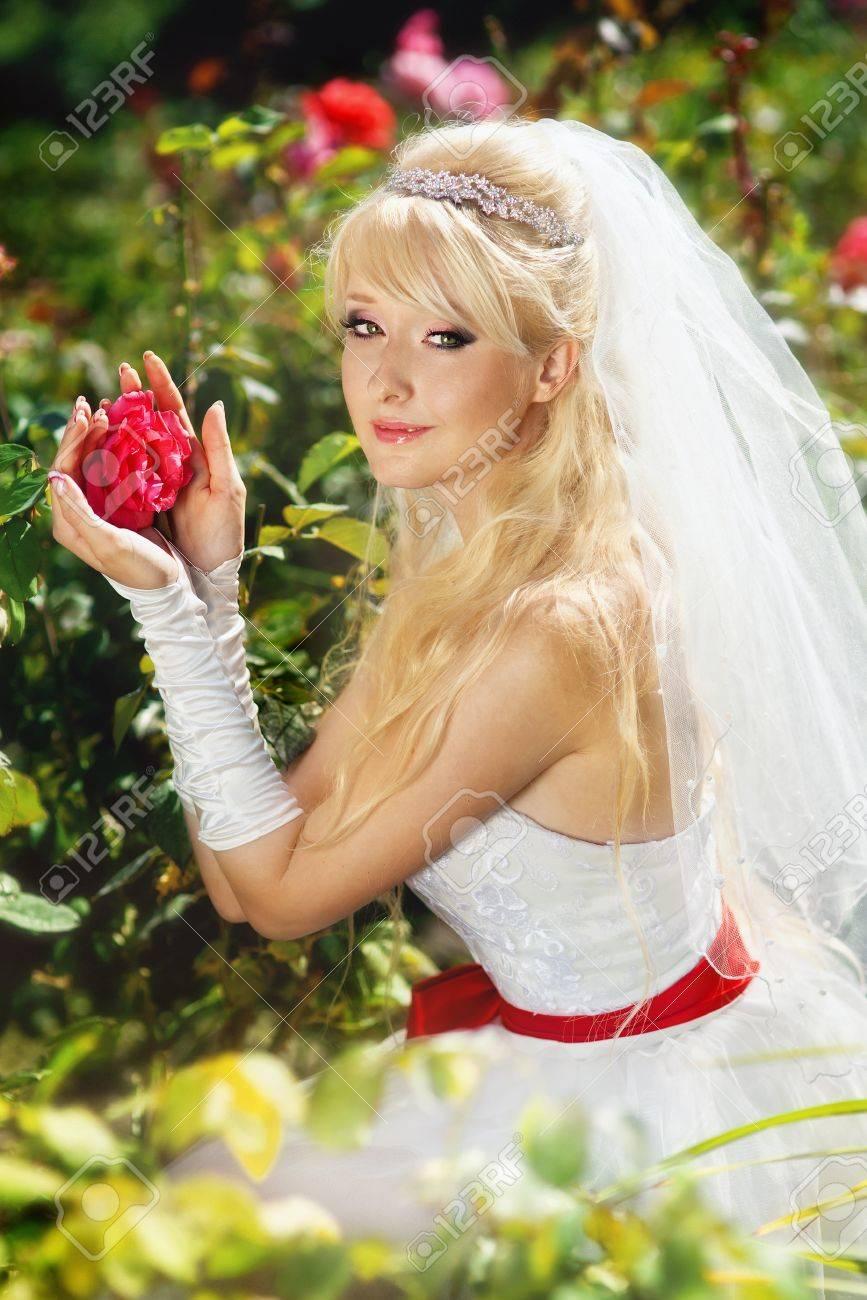 Very beautiful blonde in a wedding dress. Stock Photo - 16624321