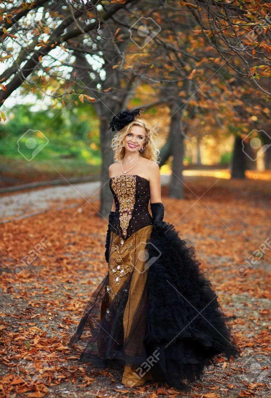A woman walks in autumn park Stock Photo - 16884351