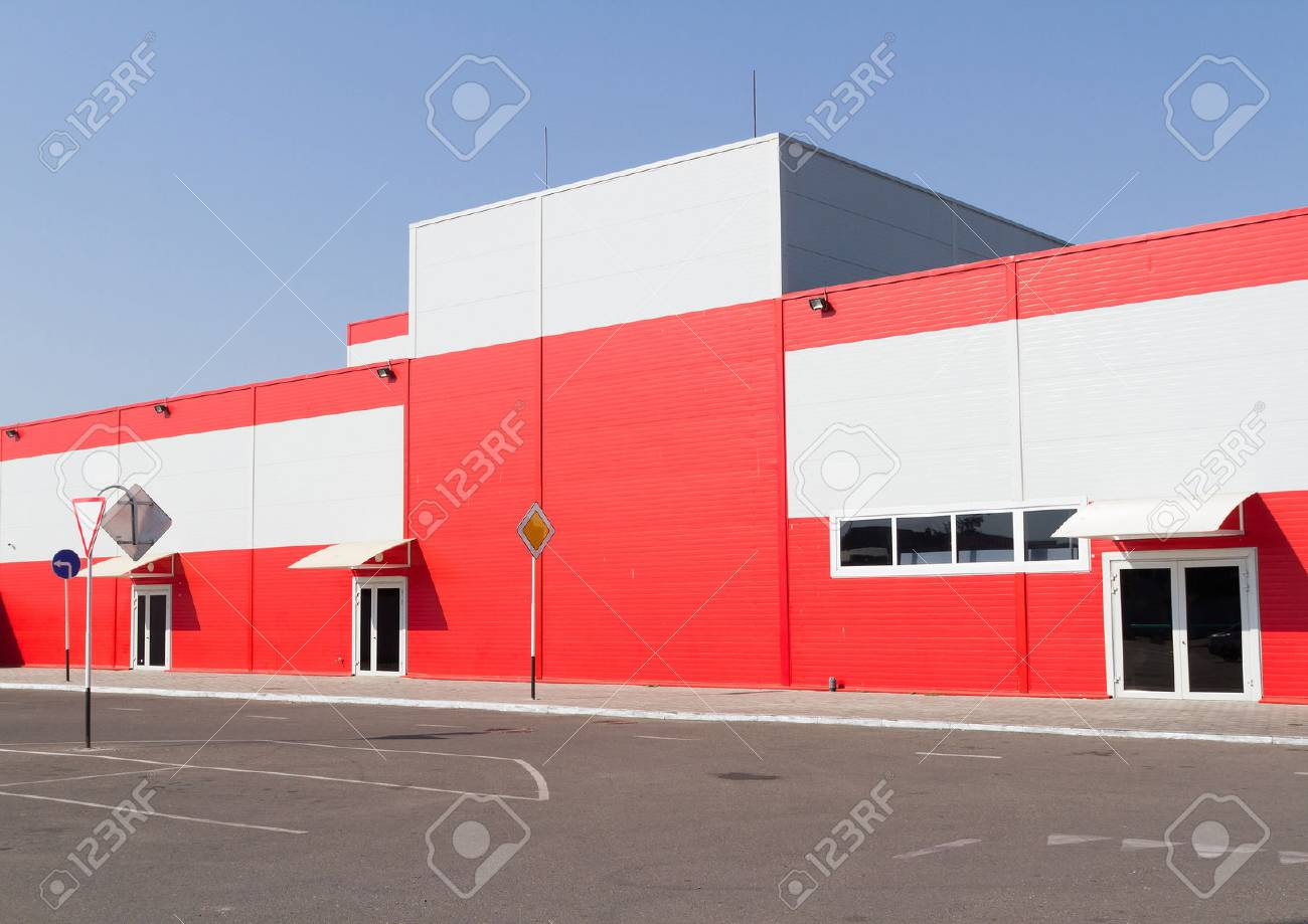 On the facade of a large industrial building made of aluminum panels red. - 45720918