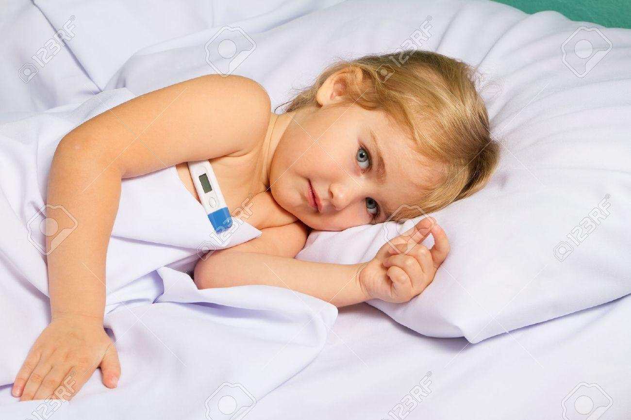 Sick little girl in bed.Virus, flu, cold, fever. - 49533710