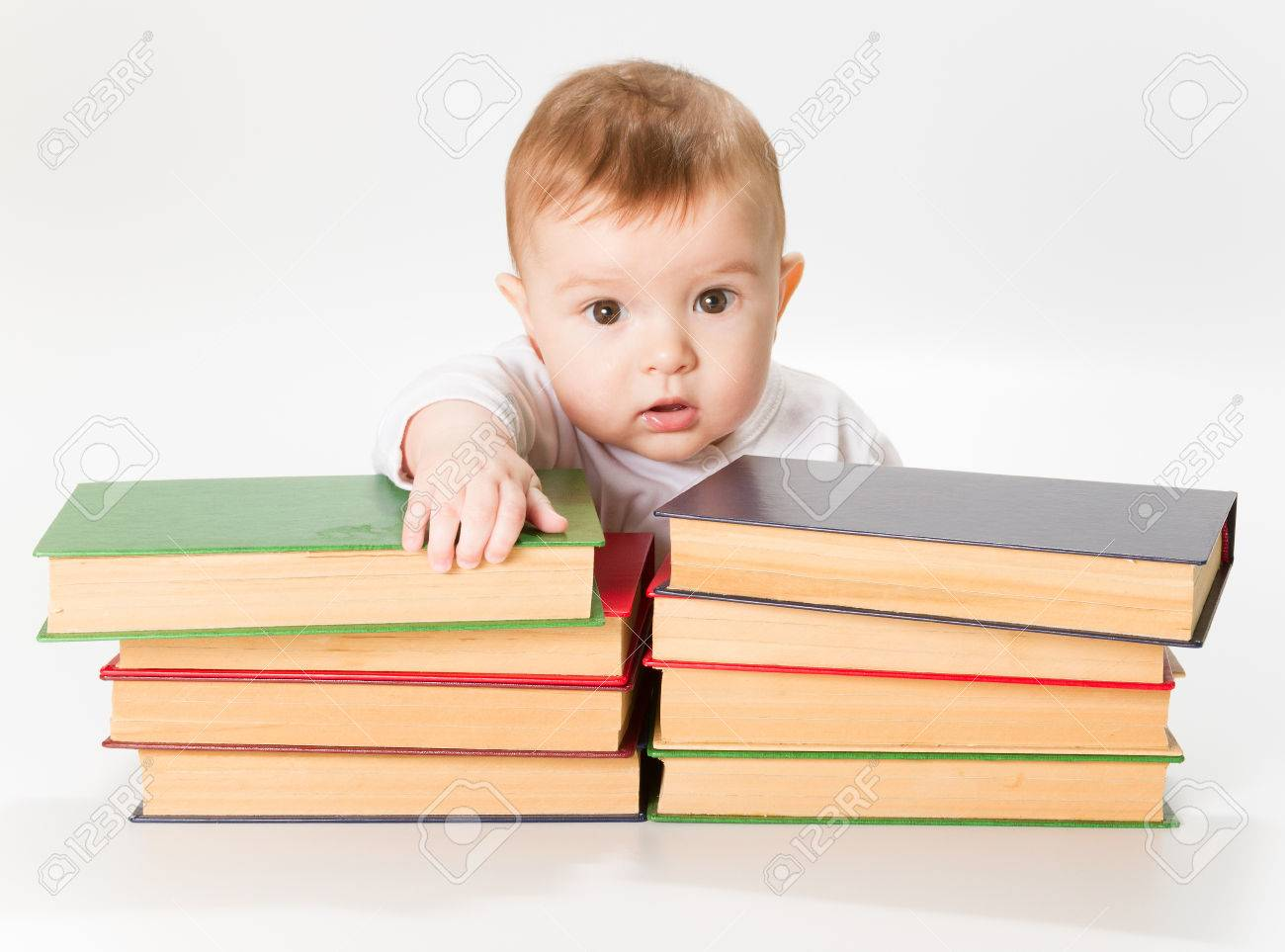Baby and books kids early childhood education development smart child preschool reading concept