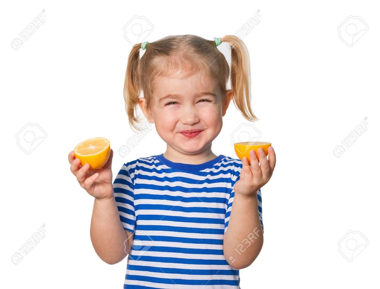 Little Funny girl in striped shirt keeps lemons. Isolated on white background - 50884728
