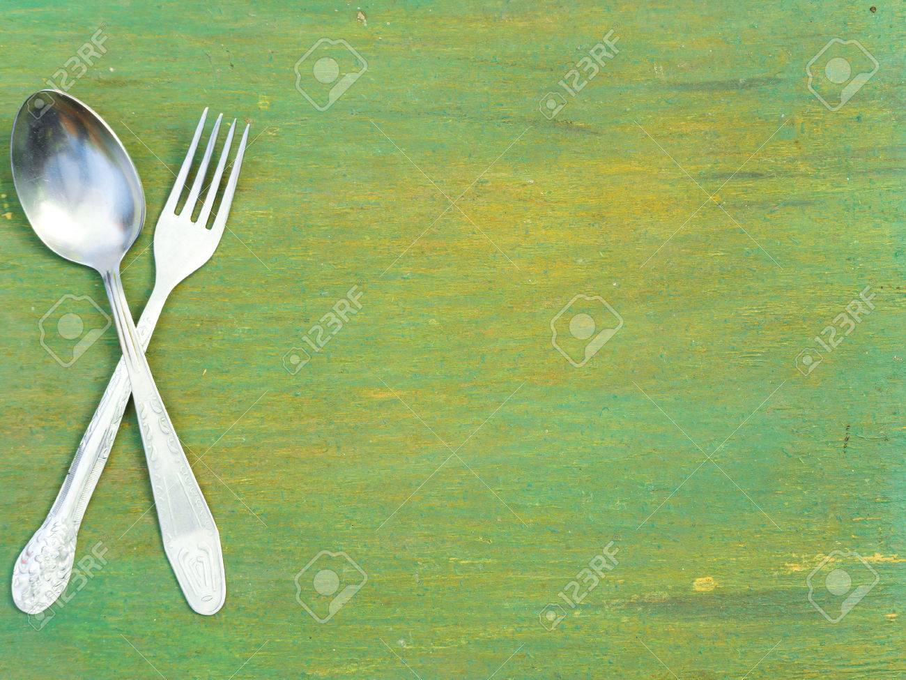 Fork and spoon on old wooden table. Vintage texture, background. Menu. - 50884776
