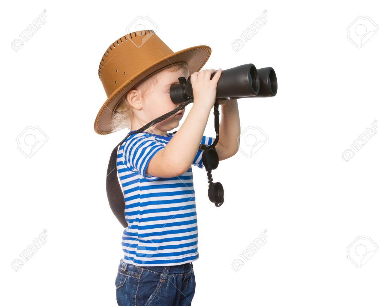 Little Funny girl in striped shirt and hat looking through binoculars. Isolated on white background - 50886763