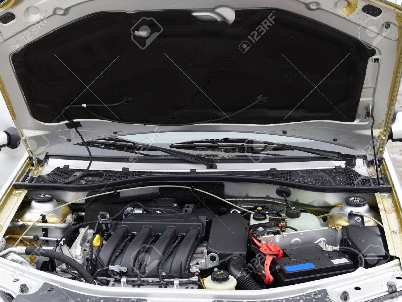 Car with open hood.Battery. Details of new car engine. - 53131275