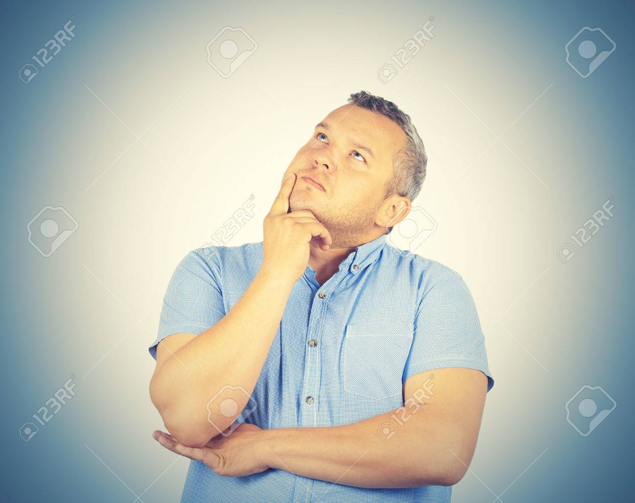 Fat Man Chin On Hand Thinking Daydreaming Staring Thoughtfully Upwards Stock Photo