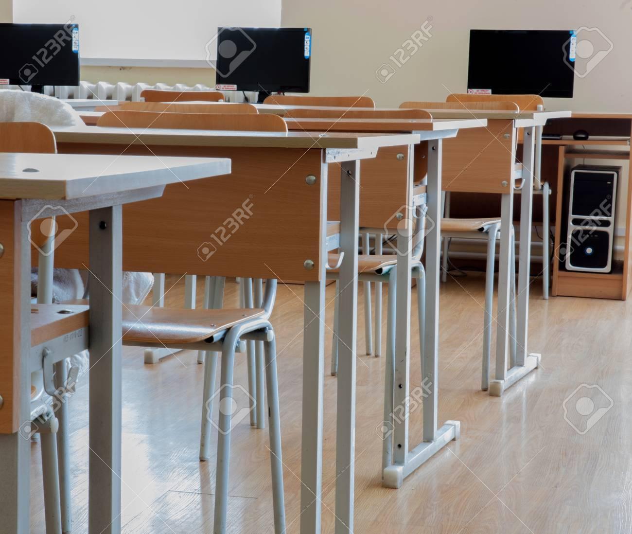 Elementary school classroom in Ukraine, school desks in the computer..