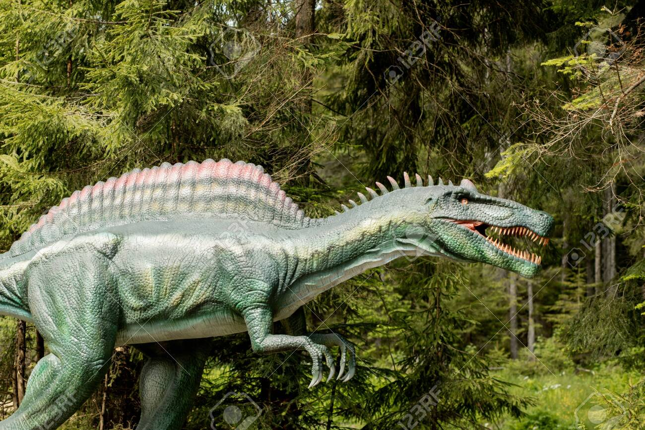 Lots of different dinosaurs in the park. - 155185743