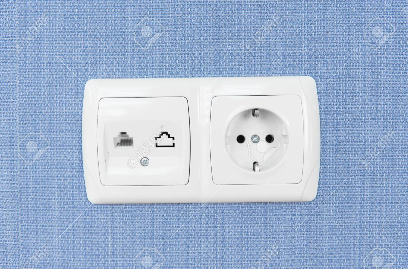Socket on a blue wall, a multifunction outlet with an internet