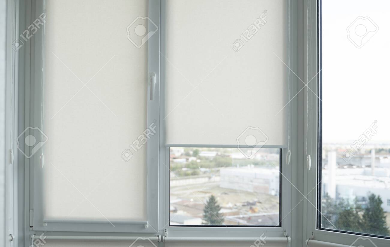 Details Of White Fabric Roller Blinds On The Plastic Window With Stock Photo Picture And Royalty Free Image Image 146187923