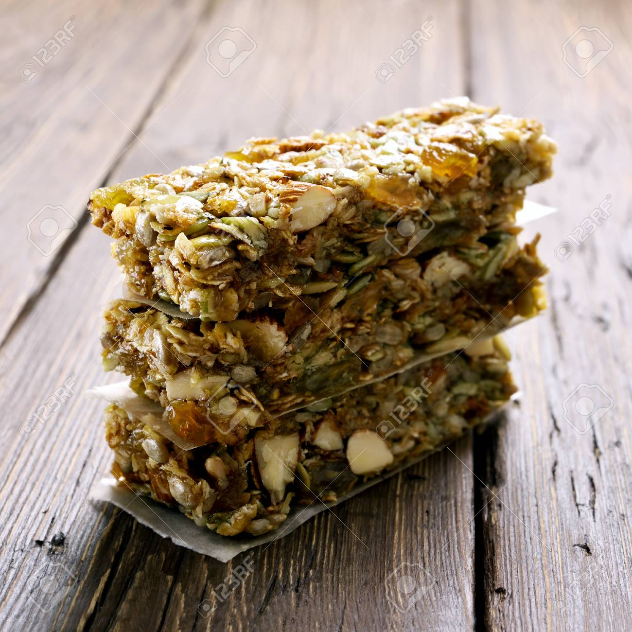 Stacked granola bars  Healthy energy snack on wooden table  Shallow