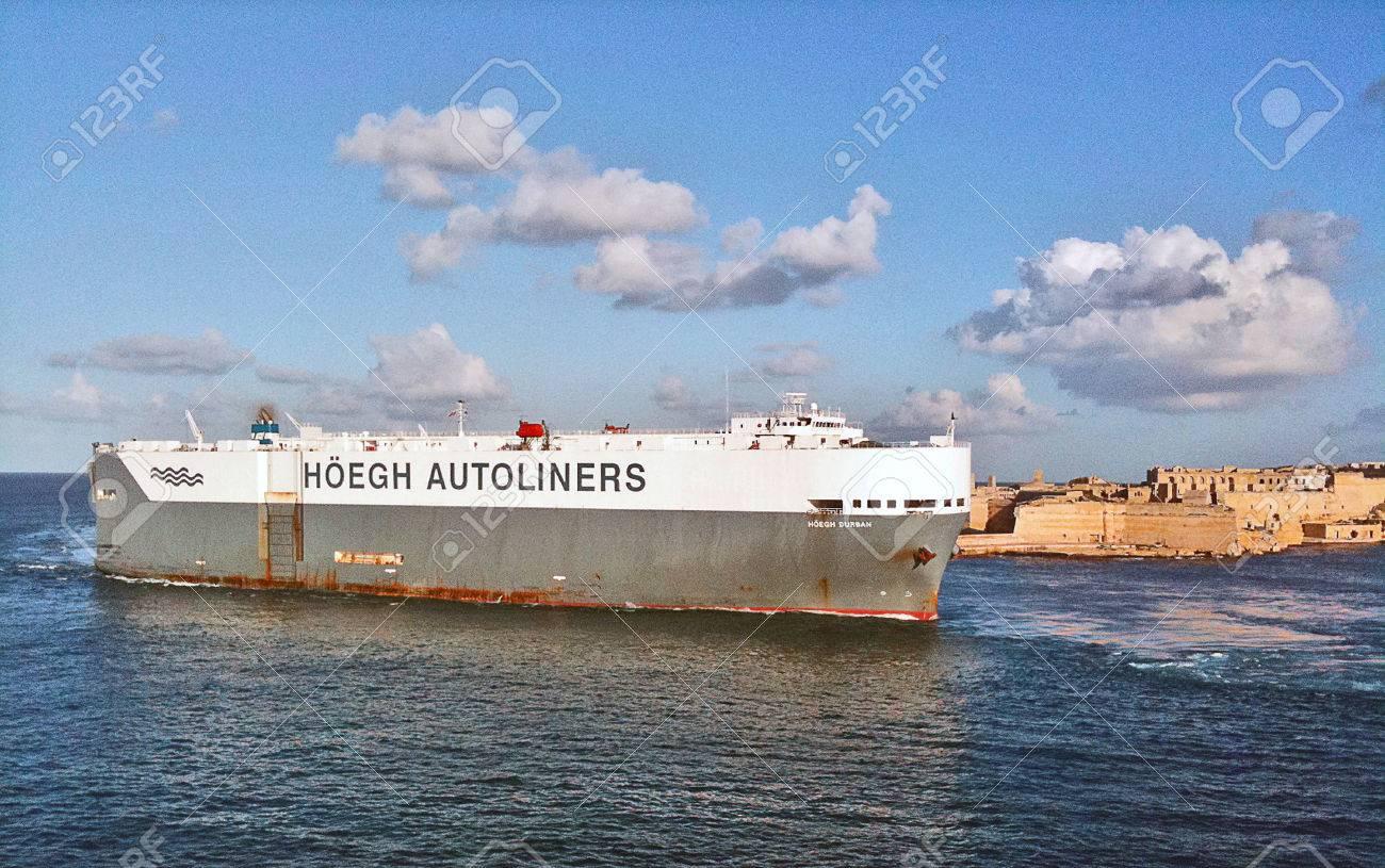 Freighter Ship leaving Valletta Harbor - 34360222
