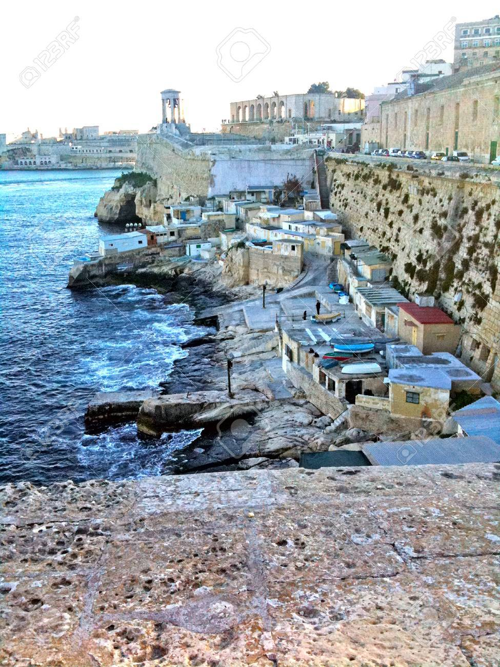 A small fishing town nestled in a natural harbor somewhere in Malta - 34392176