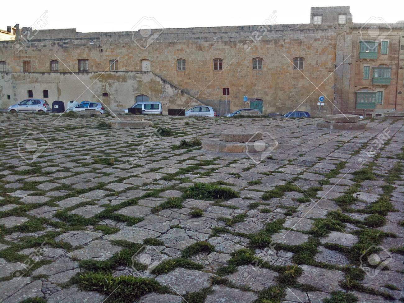 A public area clad in stonework - 34360461