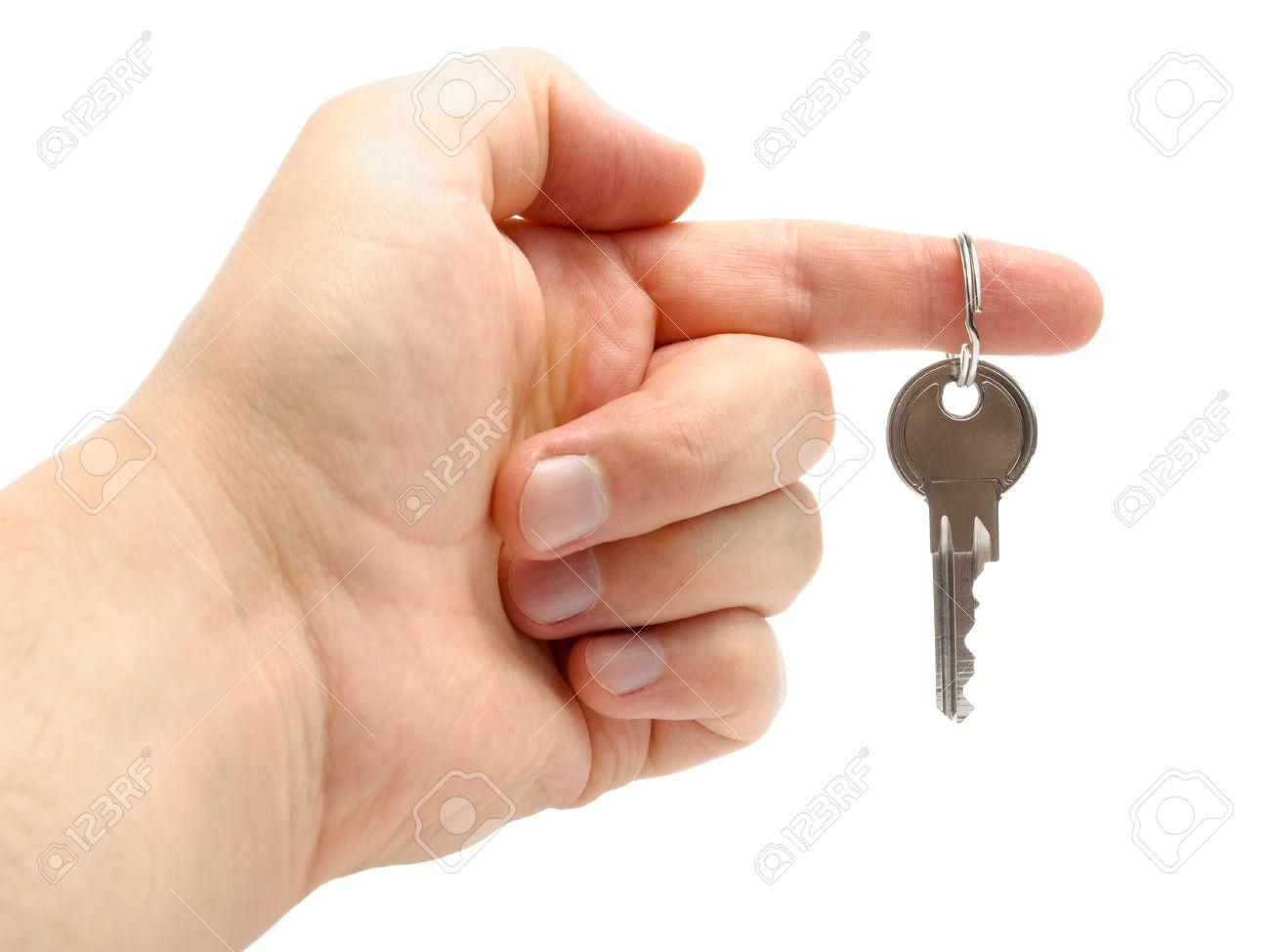 Een Nieuw Huis : Hand houden van de sleutel van een nieuw huis geïsoleerd op witte