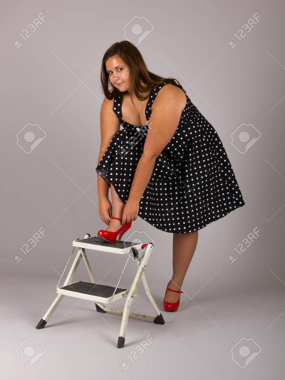 Beautiful Curvy Teenage Girl In Polkadot Dress And Red Heels Stock Photo Picture And Royalty Free Image Image 95330002