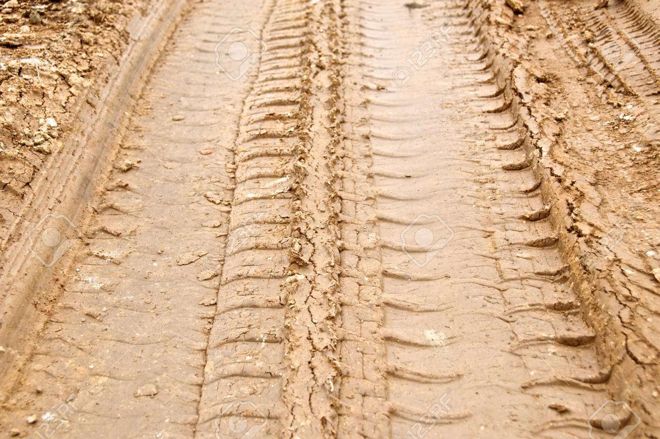tire track on muddy road Stock Photo - 13328852