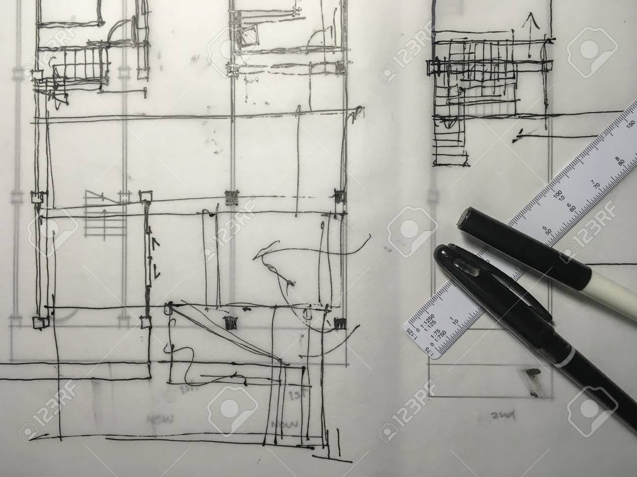 freehand black ink sketch drawing of building structure on tracing