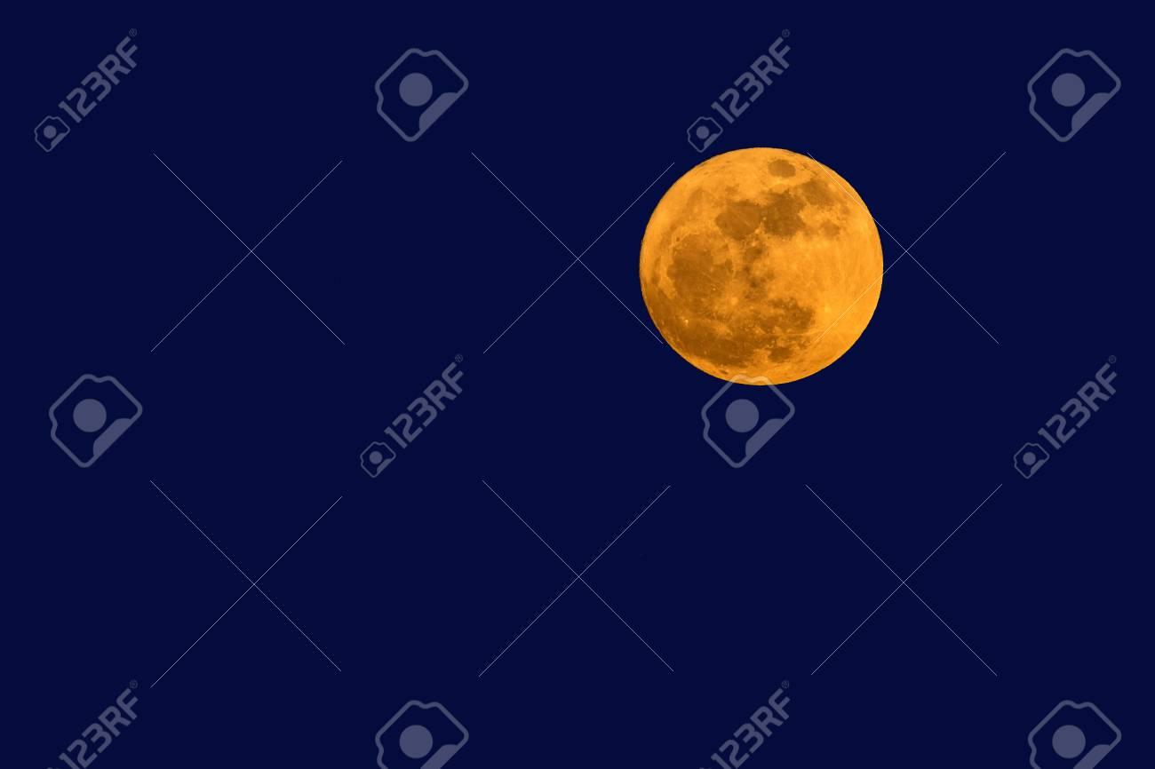 Big full moon in twilight sky. - 90768503
