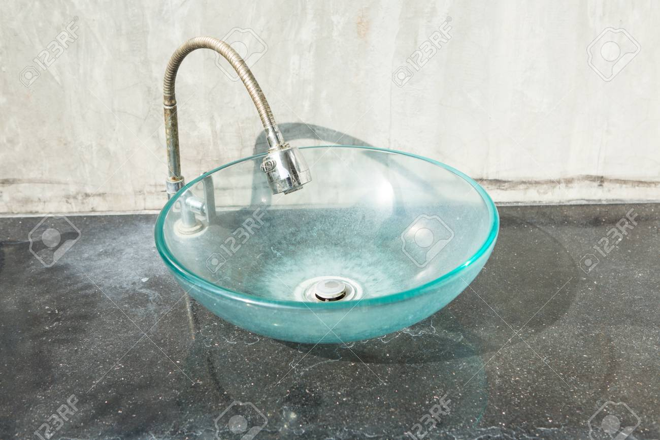 old and dirty glass bowl hand wash basin