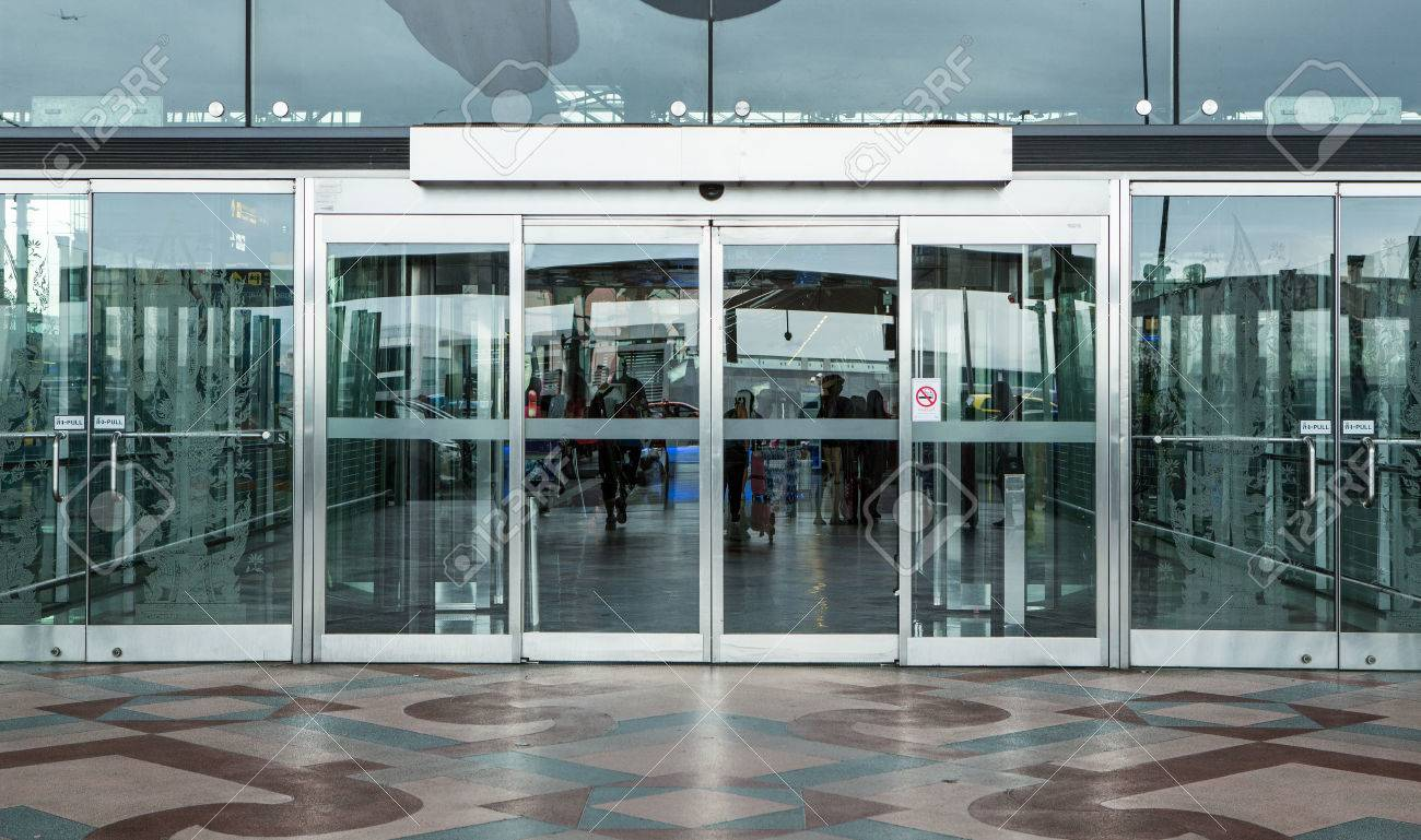 Airport terminal building gate entrance and automatic glass door airport terminal building gate entrance and automatic glass door stock photo 78622098 planetlyrics Image collections