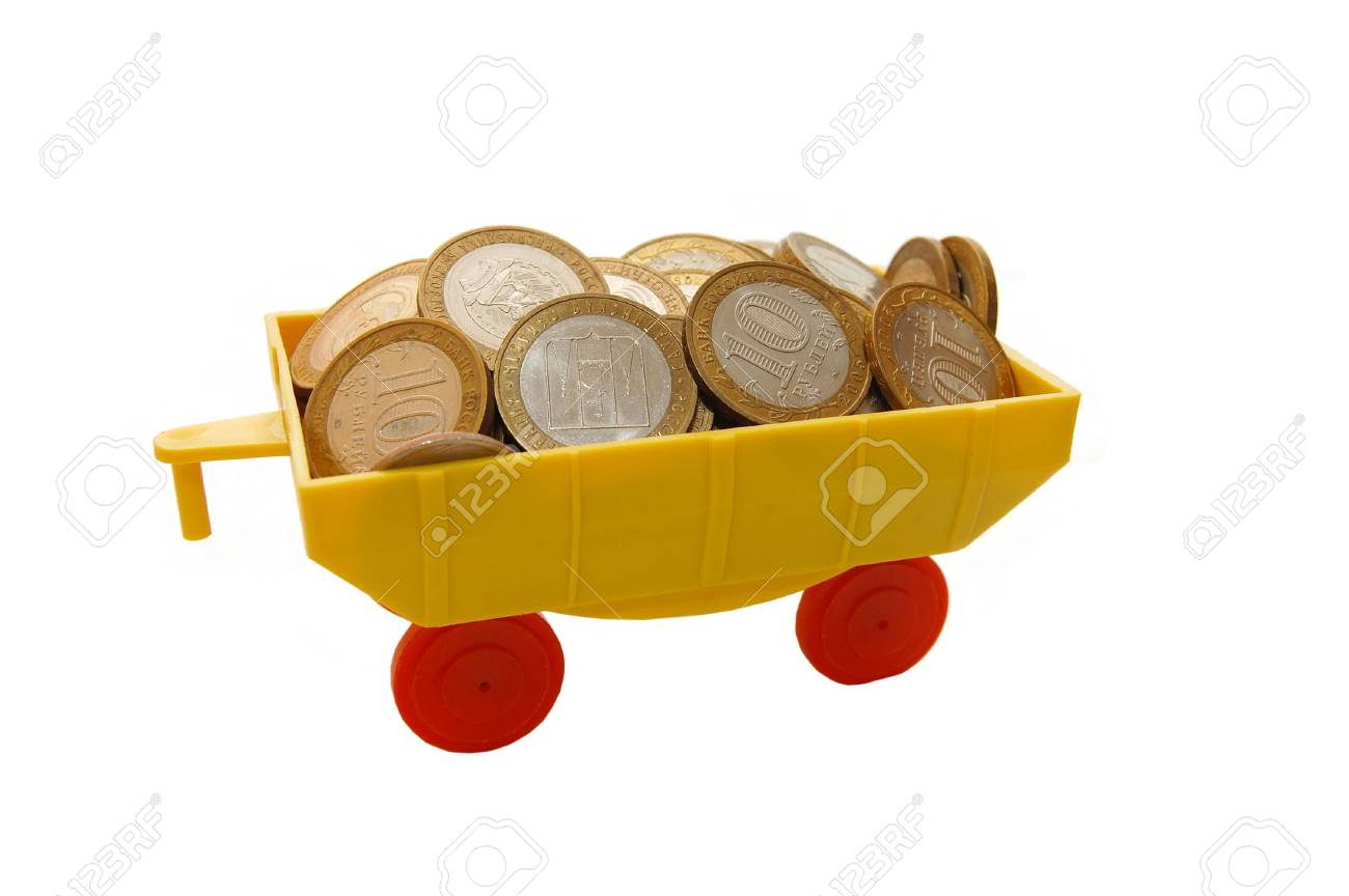 Toy train carrying coins on a white background Standard-Bild - 5097031