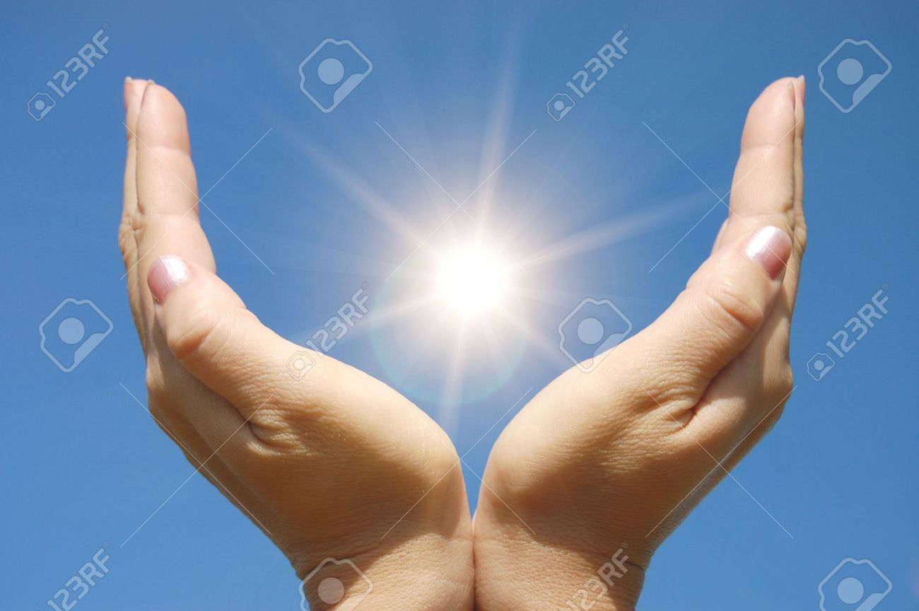 Female hands touching the Sun Stock Photo - 5258196