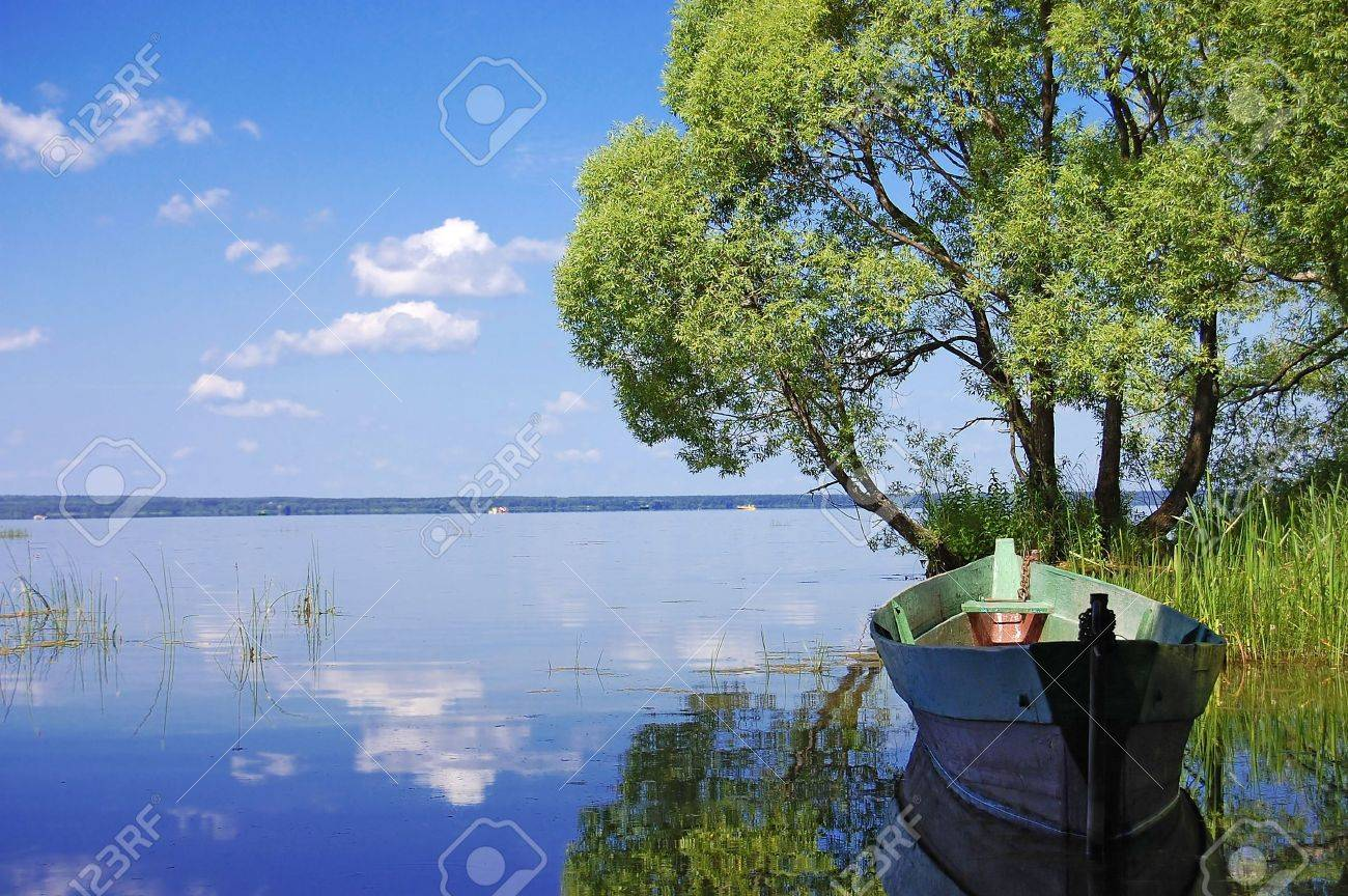 Wooden boat on the bank of lake Stock Photo - 5258282