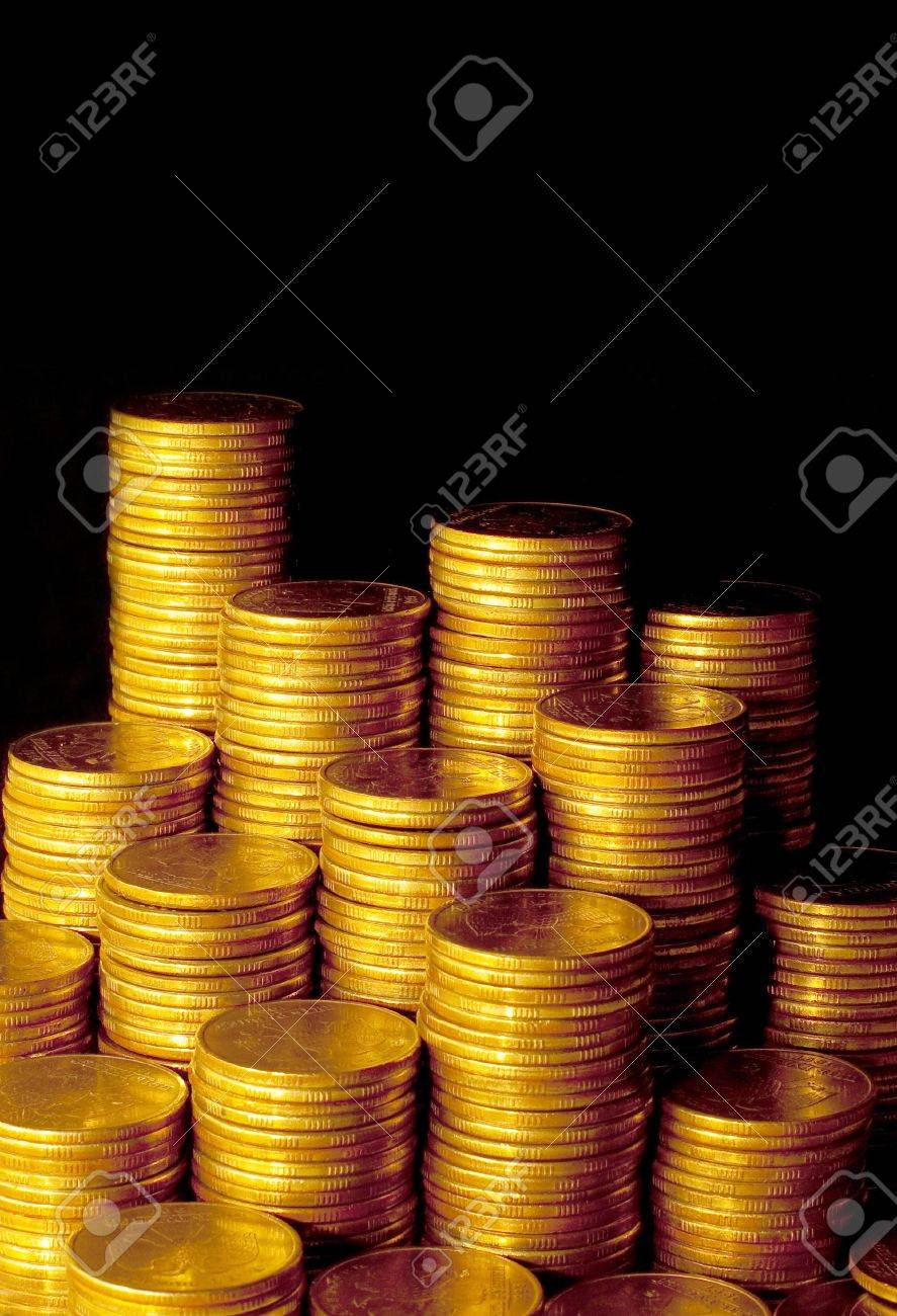 Golden coins isolated on black background Stock Photo - 5960601