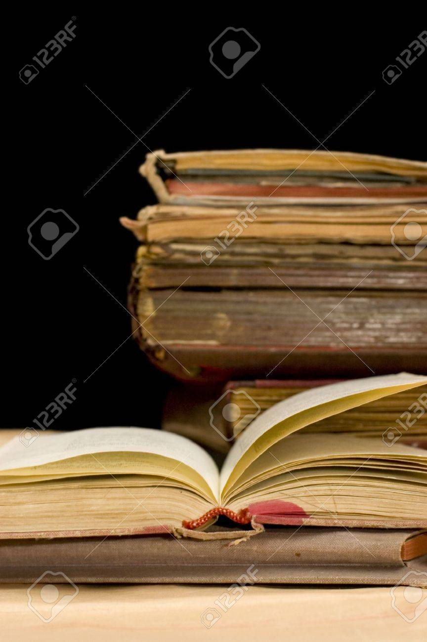 Pile of old books on black background Stock Photo - 6044544