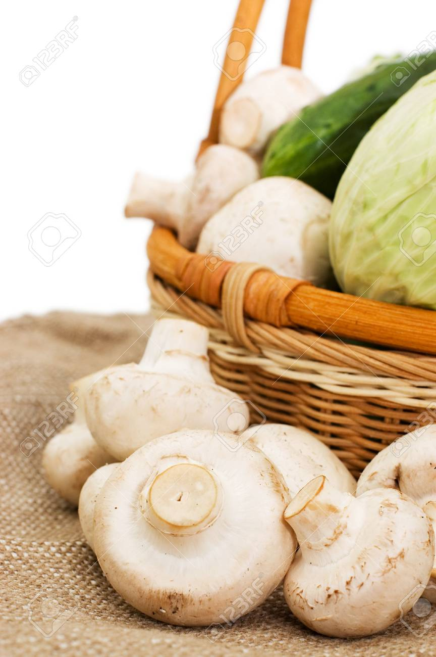 Wattled basket with vegetables isolated on white Stock Photo - 6818031