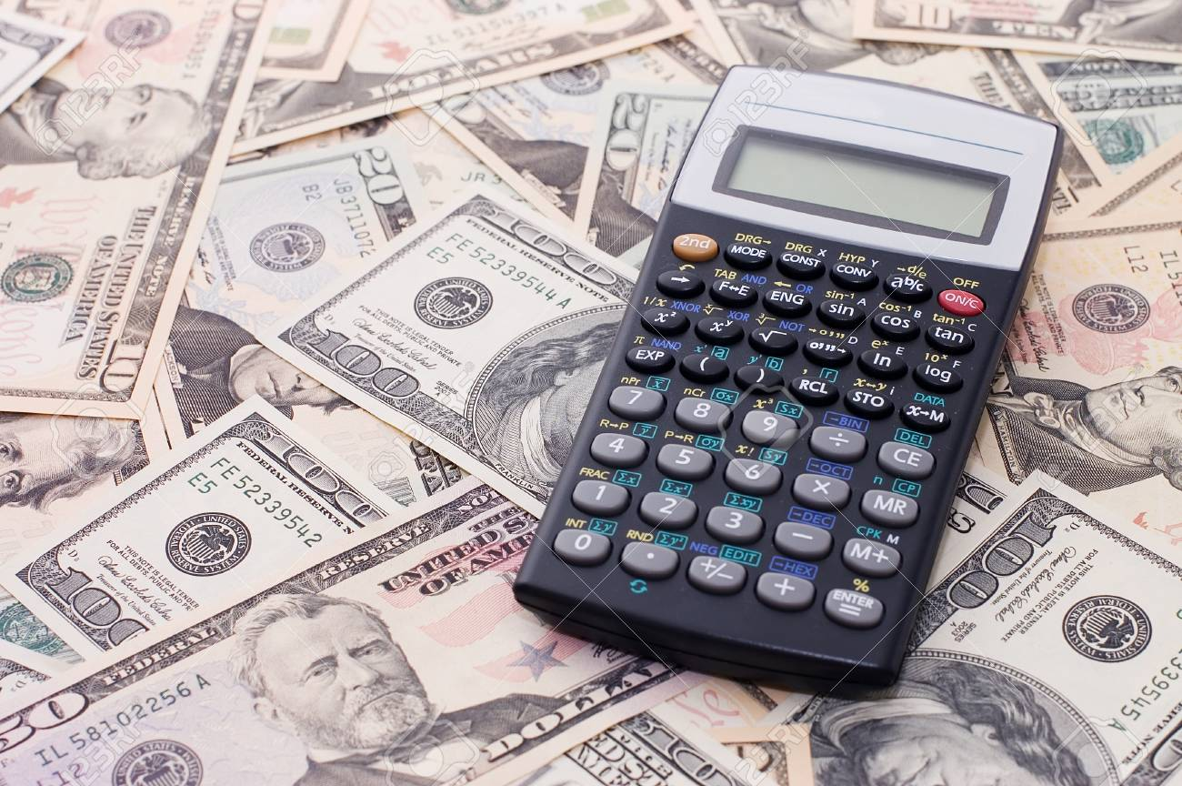 calculator on dollar background - business concept Stock Photo - 7884596