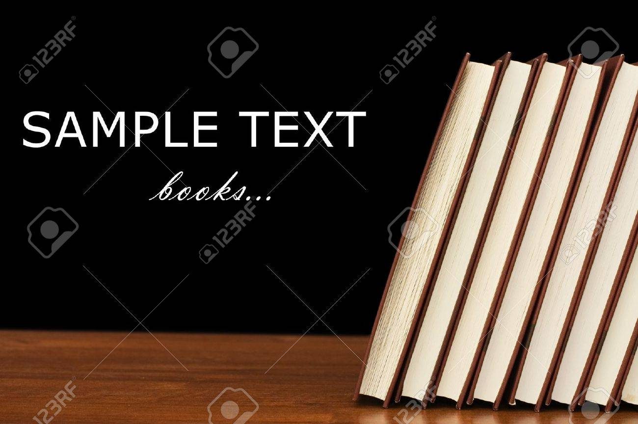 Books on a wooden table on a black background Stock Photo - 8451956
